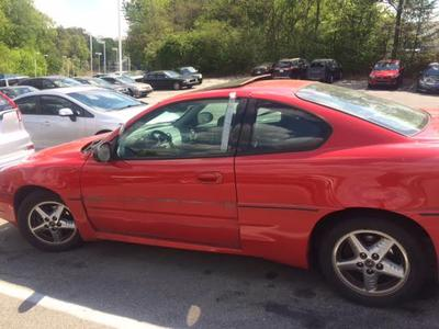 Red Pontiac Grand AM
