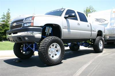 White Jacked Up Chevy Trucks