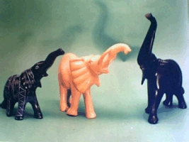 Hand carved elephants in soapstone material.
