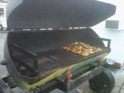 This is a large Jamaican Grill which can cook 100 lbs. of chicken at once!
