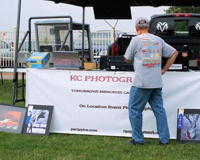 Storefront 10x10bk tent,  large screen monitors for photo view, organized and professional.