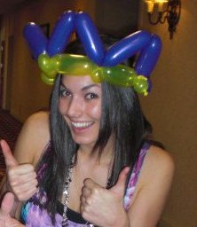Julia gives two thumbs up to our masterful balloon twister.