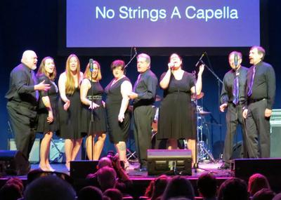 No Strings A Cappella on stage.