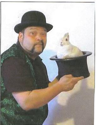 Hilarious magician--producing his rabbit.