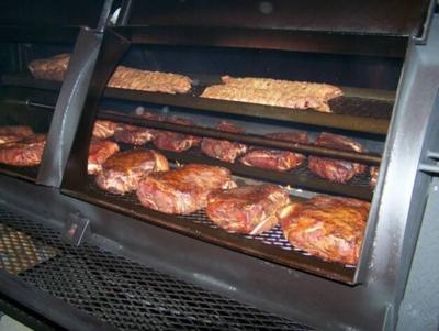 Southern Style Bbq Rotisserie Smoked Ribs And Boston Butts Pulled Pork Smoked Stuffed Potatoes Madison Mississippi